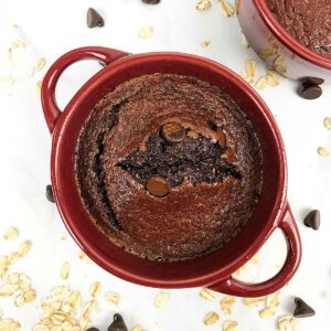 top view of a chocolate baked dessert in a red ramekin